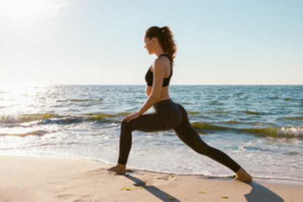 girl on beach exercising, lunges, weight gain
