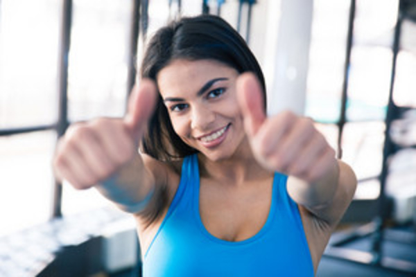 fit girl thumbs up, healthy weight gain, exercise to gain weight