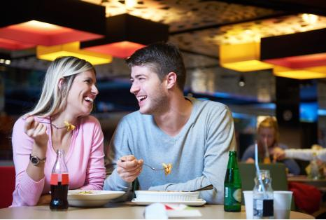Two people eating at restaurant